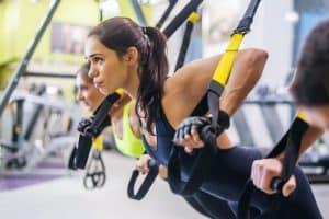 Women exercising on TRX