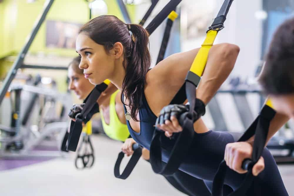 Women exercising on TRX